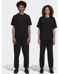 adidas Pharrell Williams Basics Joggingbroek (uniseks) - Zwart