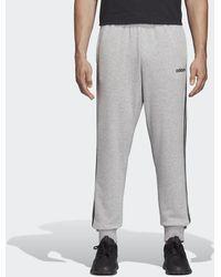 adidas Pantaloni Essentials 3-Stripes Tapered Cuffed - Grigio