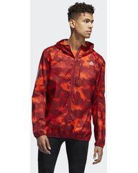 Own The Run Camouflage Jacket Orange