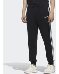 adidas Pantalón Essentials Tapered Cuffed 3 bandas - Negro