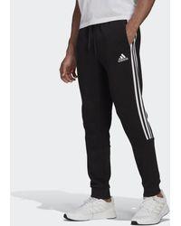 adidas Essentials Fleece Tapered Cuff 3-stripes Trousers Black