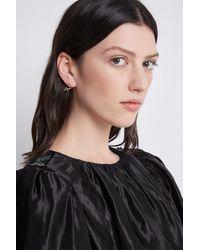 Aje. Organic Wrap Earring - Metallic