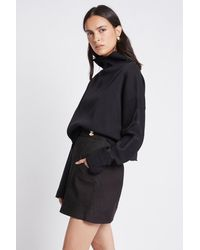 Aje. Lux Asymmetric Skirt - Black