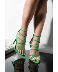 25a6b997a8f860 Lyst - AKIRA Spike It Up Pvc Strappy Sexy Sandals in Metallic