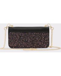 6bea65bb2d2 Lyst - ALDO Anapple Embellished Clutch in Black
