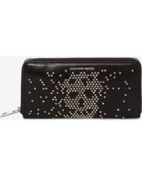 Alexander McQueen Große klappbare Brieftasche aus Leder mit Nieten - Schwarz