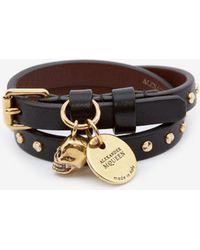 Alexander McQueen Bracelet double tour avec clous martelés - Noir