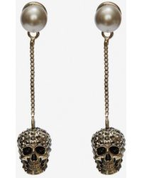 Alexander McQueen Boucles d'oreilles avec chaîne et skull pavé - Métallisé