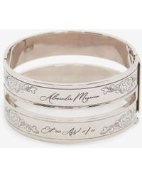 Alexander McQueen Cut-out Engraved Cuff - メタリック