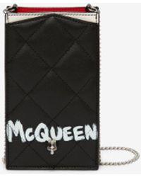 Alexander McQueen Mcqueen graffiti phone case with chain - Schwarz