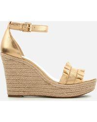 3bbd491b5b8 MICHAEL Michael Kors - Bella Wedge Women s Sandals In Gold - Lyst