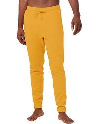Alo Yoga The Triumph Sweatpant - Yellow