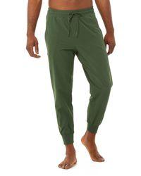 Alo Yoga Alo Yoga Co-op 78 Trousers - Green