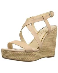 40ad67ba296 Lyst - Jessica Simpson Pressa Platform Wedge Sandal in Natural