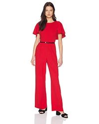 4f39a3c04fc4 Lyst - Calvin Klein Belted Ruffle-sleeve Jumpsuit in Red