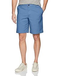 "Izod Saltwater 9.5"" Flat Front Chino Short - Blue"