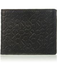 Calvin Klein Logo Embossed Billfold W/ Coin Pocket - Black