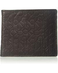 Calvin Klein Logo Embossed Billfold W/ Coin Pocket - Brown