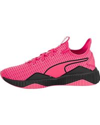PUMA Defy Women's Sneakers Color KNOCKOUT PINK Puma Black