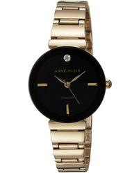 Anne Klein Ak/2666rgbk Swarovski Crystal Accented Rose Gold-tone And Black Leather Strap Watch