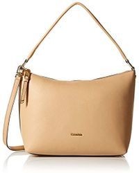 e8714a10d2c Calvin Klein North South Pebble Leather Crossbody in Natural - Lyst