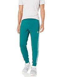 adidas Originals Synthetic 3 Stripe Track Pants in Green