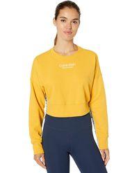 Calvin Klein Vintage Logo Tape Crew Neck Crop Pullover - Yellow