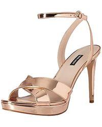 9bb1ae35c94d Lyst - Nine West Rose Gold Quisha Platform Patent Sandals in Red