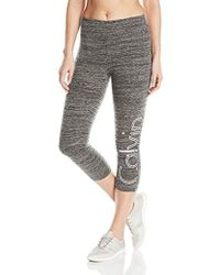 4701e2d8db4 Calvin Klein - Performance Large Outline Cut Off Logo Crop Legging - Lyst