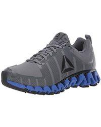 386ee25896 Reebok Zigwild Tr 3 Running Sneakers in Blue for Men - Lyst