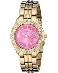 afb32ef28efe Guess - U0148l4 Sporty And Classic Mid-size Gold-tone Watch With Pink Dial