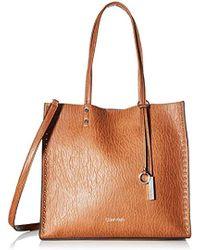 4347b9da3013c Lyst - Michael Kors Zoey Large Pebble Leather Satchel Bag in Brown