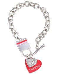 Guess Bracelet à maillons avec breloques en forme de cœur et verrou - Métallisé