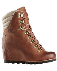 8c48fcf8ba55 Lyst - Sorel Conquest Wedge Holiday Boot in Brown