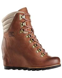 00c1f5d8fcb Lyst - Sorel Leather Conquest Wedge Holiday Boots in Brown