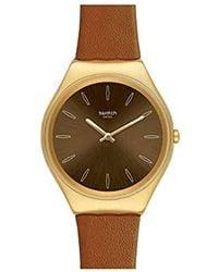 Swatch Damen Analog Schweizer Quarz Uhr mit Echtes Leder Armband SYXG104 - Braun