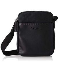 Calvin Klein - Multi Task Mini Reporter Shoulder Bag - Lyst