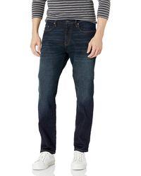 Amazon Essentials Pantalones vaqueros elásticos de corte atlético para hombre - Azul
