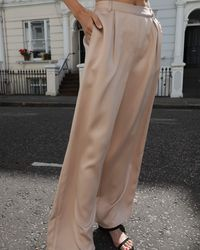 The Drop @leoniehanne Beige Loose High Rise Wide Leg Silky Pant - Natural