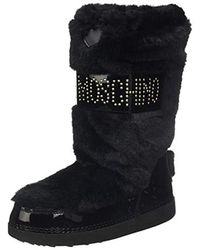 reputable site a1737 57bf2 Love Moschino Women's Faux - Fur Moon Boots in White - Lyst