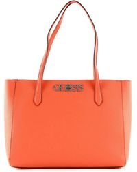 Guess - Uptown Chic Elite Tote Uptown Chic Elite Tombe pour femme - Lyst