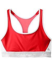 d0beac4fe4 Calvin Klein - Flex Motion Medium Impact Racerback Sports Bra - Lyst
