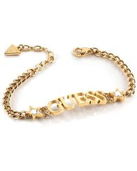 Guess Bracelet A Star Is Born Ubb70075-s Stainless Steel Gold Plated Swarovski Logo Curved Stars - Metallic