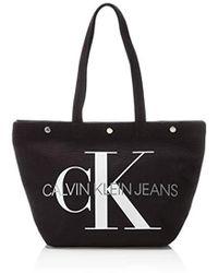 Calvin Klein Damen Canvas Utility Ew Bottom Tote M 15x31x46 cm - Schwarz