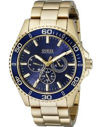 Guess U0172G5 Sporty Gold-Tone Stainless Steel Watch with Multi-function Dial and Deployment Buckle - Bleu