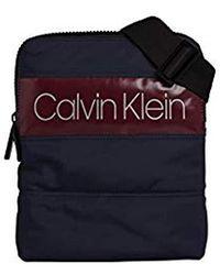 Calvin Klein Puffer Flat Crossover Schultertasche, 3x26x21 cm - Blau