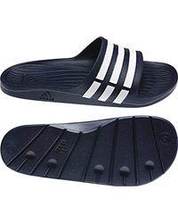 2c01713c2d5 Adidas Duramo Slide Unisex Pool Sandals in Blue for Men - Lyst