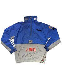 sale retailer a4c8b 8aef5 X Pharrell Williams Human Race Half Zip Wind Breaker Jacket - Blue