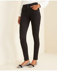 Ann Taylor Petite Sculpting Pocket High Rise Skinny Jeans In Jet Black Wash