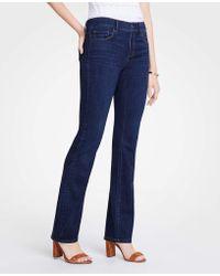 Ann Taylor - Curvy Denim Boot Cut Jeans - Lyst